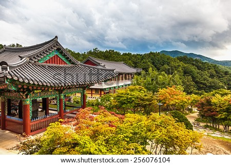 Traditional asian buddhist monks temple in mountains in South Korea at autumn - stock photo