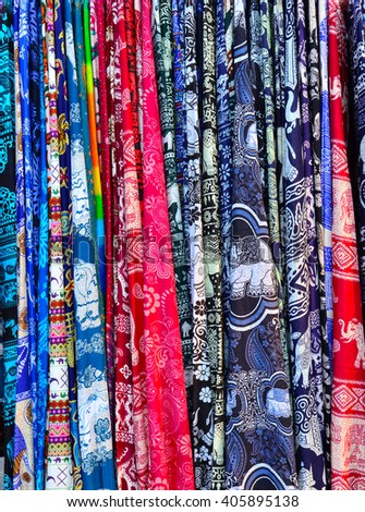 Traditional Asian fabrics and clothes for sale in a shop  - stock photo