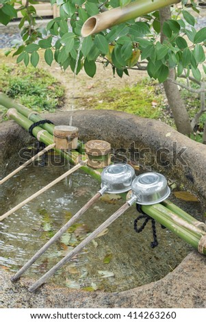traditional asian fountain in temple, Japan - stock photo