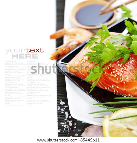 traditional asian ingredients (Fresh salmon steak filet,  ginger, lemon,  soy sause and chopsticks) over white with sample text - stock photo