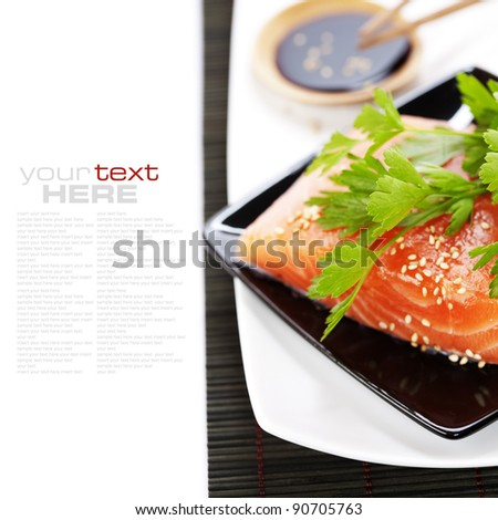 traditional asian ingredients (Fresh salmon steak filet,  soy sause and chopsticks) over white with sample text - stock photo