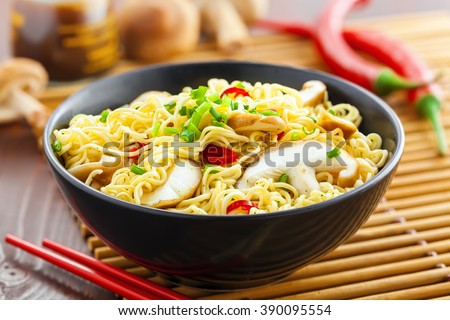 Traditional Asian instant noodles meal with shiitake mushrooms and vegetables - stock photo