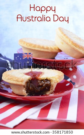 Traditional Australian Meat Pies for Australia or Anzac Day holiday party food, in red, white and blue setting with copy space. - stock photo