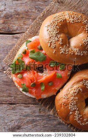 Traditional bagel with salmon and cream cheese on the table.  top view vertical  - stock photo