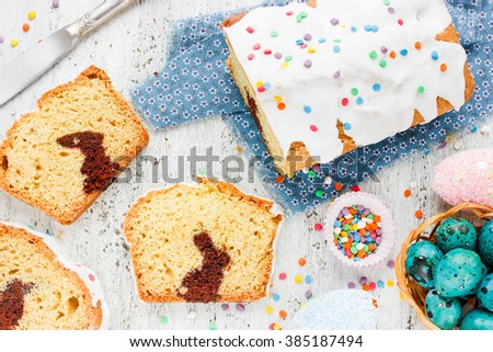 Traditional baking for Easter holiday: cake with chocolate bunny inside, creative treats for children on Easter dessert - stock photo