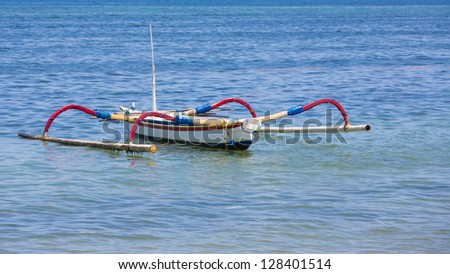 Traditional Balinese Fishing Boat on the sea - stock photo