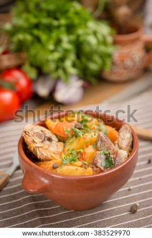 Traditional Balkan dish - Roast in a pot with beef and carrots rustic dish
