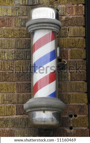 traditional barber shop pole - stock photo