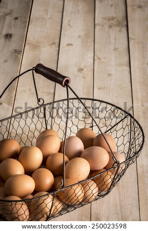 Traditional basket with a lot of ecological eggs from home hens - stock photo