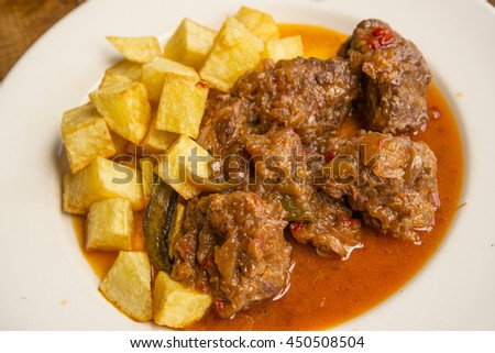 Traditional beef stew with sauce - stock photo