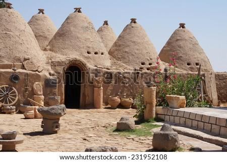 Traditional beehive mud brick desert houses, Harran near the Syrian border, Turkey - stock photo