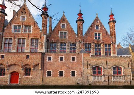 Traditional Belgian facades of houses on the Green canal  in the city of Bruges. - stock photo