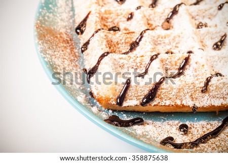 Traditional belgium soft fresh waffles with a decor on a plate. Toned.