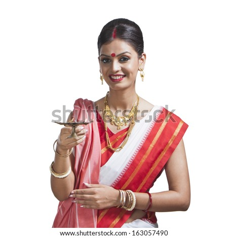 Traditional Bengali woman holding oil lamp