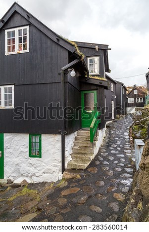 Traditional black wood and stone houses near the harbour in Torshavn, Faroe Islands - stock photo