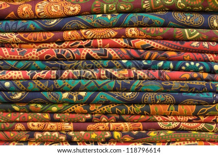 Traditional block printed fabrics on display at a local market in India - stock photo
