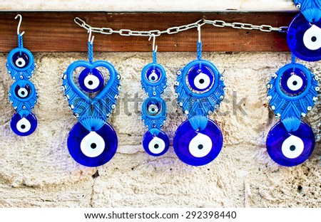 Traditional blue and white evil eye protection souvenirs from Turkey - stock photo