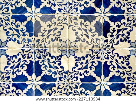 Traditional blue colored tiles decorating old Lisbon buildings.  - stock photo