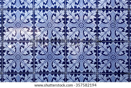 Traditional blue coloured tiles decorating the facades of many old buildings in Lisbon, Portugal. - stock photo