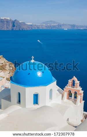 Traditional blue dome church in Santorini Greece