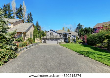 Traditional blue home exterior in Puyallup with wood siding and elegant front door. Northwest, USA