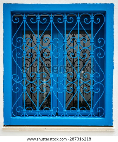Traditional blue window from Sidi Bou Said in Tunisia - stock photo