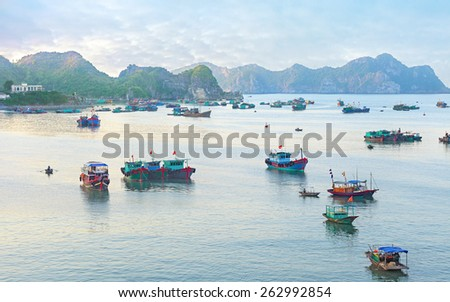 Traditional blue wooden fishing boats in the ocean, Asia - stock photo