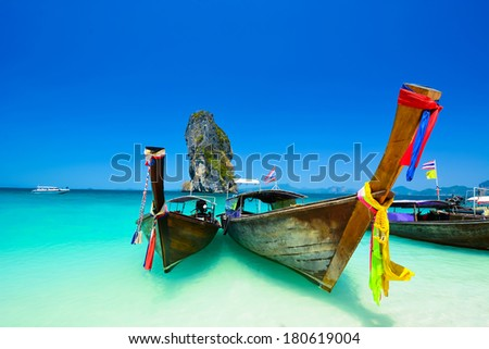 Traditional boat in the beach is one of main tourist attraction in Thailand - stock photo