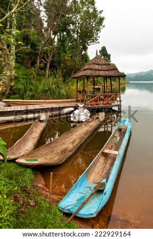 Traditional boats at Lake Bunyonyi in Uganda, Africa, at the borders of Uganda, Congo Democratic Republic and Rwanda, not far from the Bwindi National Park, home of the last mountain gorillas - stock photo