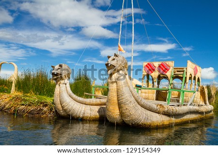 Traditional boats in the floating and tourist Islands of lake Titicaca Puno Peru South America