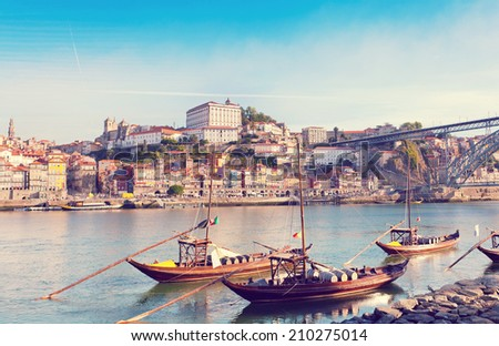 traditional boats with wine barrels, old Porto, Portugal (warm colors toned) - stock photo