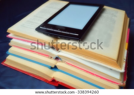 Traditional books and electronic book - stock photo
