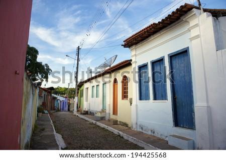 Traditional Brazilian Portuguese colonial architecture on a cobblestone street in Nordeste Bahia Brazil - stock photo