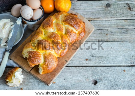 Traditional bread challah for Easter served for breakfast, space for your text, selective focus - stock photo
