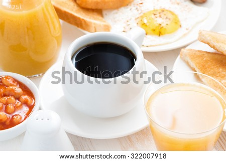traditional breakfast - coffee, juice, eggs, toast on table, close-up - stock photo