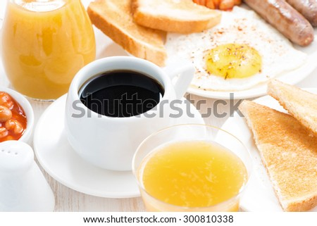 traditional breakfast - coffee, juice, eggs, toast, top view, horizontal - stock photo