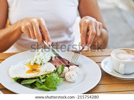 Traditional breakfast with bacon and fried eggs - stock photo
