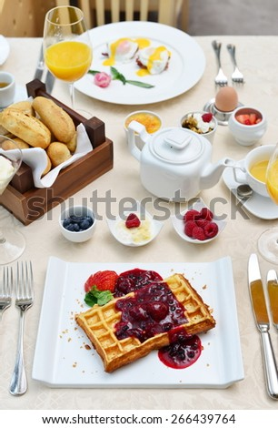 Traditional Breakfast with Bacon, Waffle, and Fried Eggs - stock photo