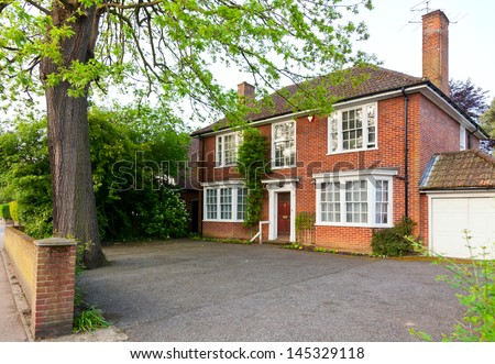 Traditional brick house in England - stock photo
