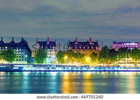 Traditional british architecture along the River Thames at night