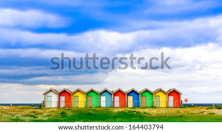 Traditional British Beach Huts - stock photo