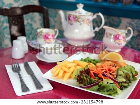 Traditional British High Tea Dinner or Lunch Fish and Chips with Salad  - stock photo