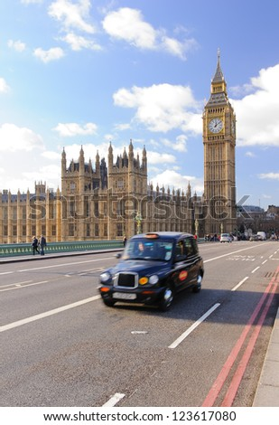 Traditional british taxi on Westminster bridge in London, UK - stock photo