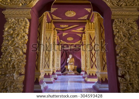 Traditional buddha golden praying set complete, taken indoor in public temple - stock photo