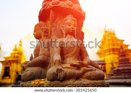 Traditional Buddha statue in Swoyambhunath Temple,  Kathmandu, Nepal - stock photo