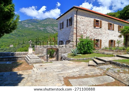 Traditional building and old grave inside orthodox monastery, Adriatic sea coast, Montenegro - stock photo