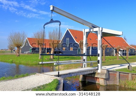 Traditional buildings and small canal and mobile bridge in Zaanse Schans, Holland