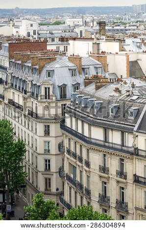 Traditional buildings and street in Paris, France - stock photo