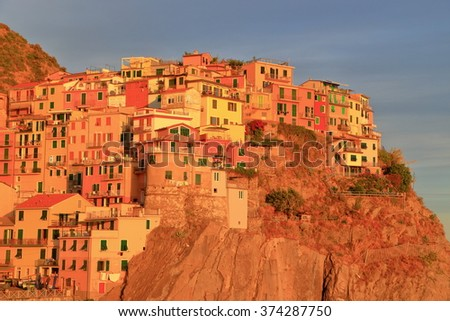 Traditional buildings of the historical village of Manarola at sunset, Cinque Terre, Italy - stock photo