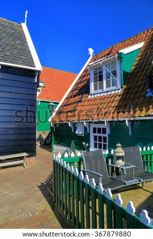 Traditional buildings with dark painted wooden walls in Marken, Holland